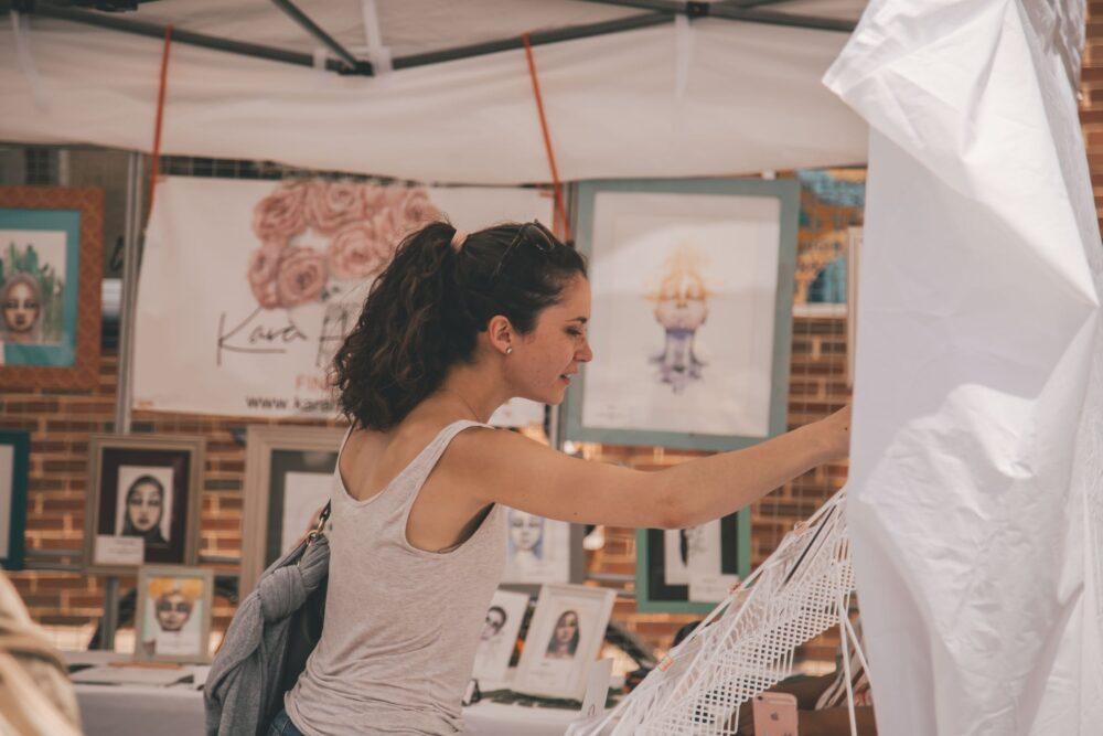 A woman enjoying local art at the Ashland First Friday Art Walk